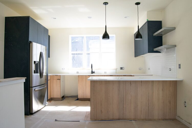 Beautiful modern kitchens with two-tone cabinetry and matte black plumbing fixtures